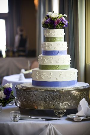 Wedding cake with flower topper photo
