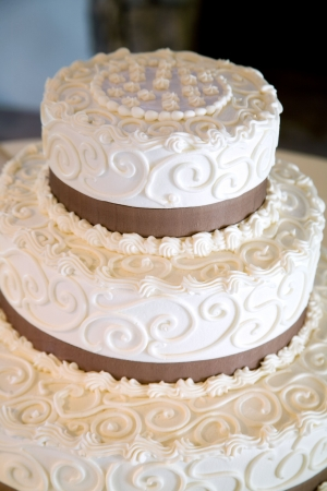 layer cake: This is a close up of a wedding cake with lots of little swirl details done with frosting Stock Photo