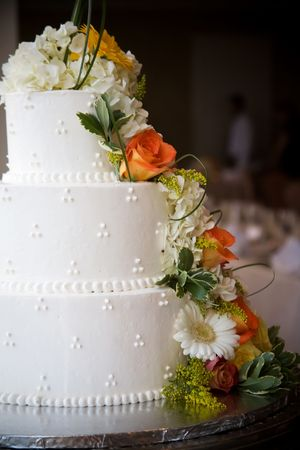 Wedding cake with flowers, shallow depth of field Stock Photo