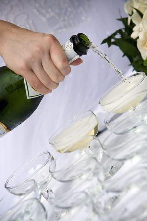 waiter pouring champagne for a toast to the bride and groom