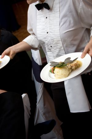 caterer: food being served by a waiter during a wedding or catered social event