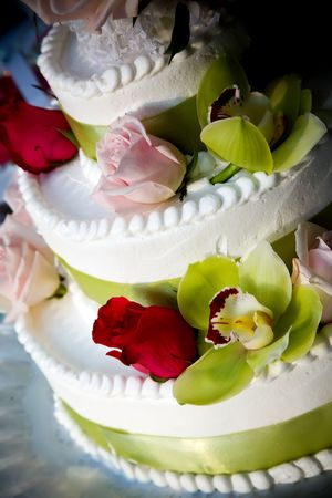 a fancy wedding cake decorated with flowers Stock Photo