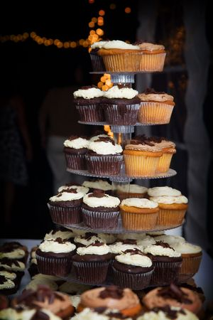 a bunch of wedding cupcakes. Many people choose cupcakes over the traditional cake Stok Fotoğraf