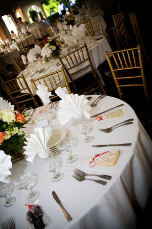 catered: table set for a wedding or catered social event, decorated cookie on the tables