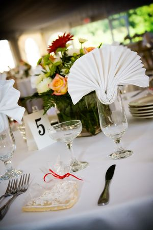 table set for a wedding or catered social event, decorated cookie on the tables Stock Photo - 2672816