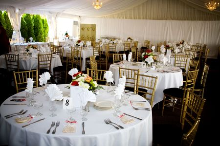 table set for a wedding or catered social event, decorated cookie on the tables