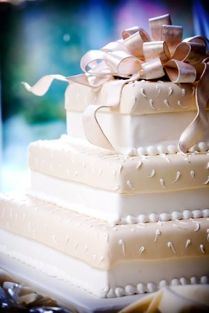 wedding cake: this is a very cool wedding cake with sugar ribbons on top
