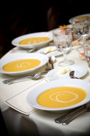 catered: Appetizer bowl of soup during a catered wedding event Stock Photo