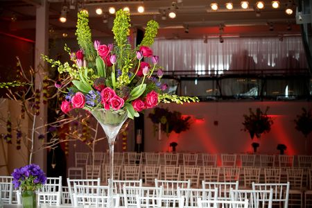 big and bold flower arrangements for the tables. Details from a wedding.
