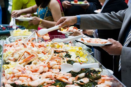 seafood platter: Photo of cooked shrimp and crab legs served at a wedding during cocktail hour. This image has a very shallow depth of field. Stock Photo