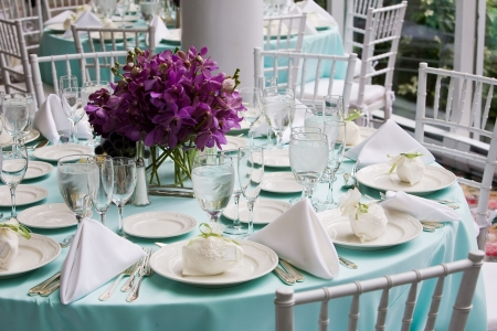 restaurant setting: Fancy table settings during a wedding or special event