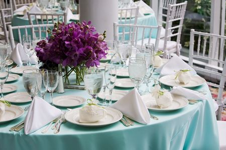 seating: Fancy table settings during a wedding or special event