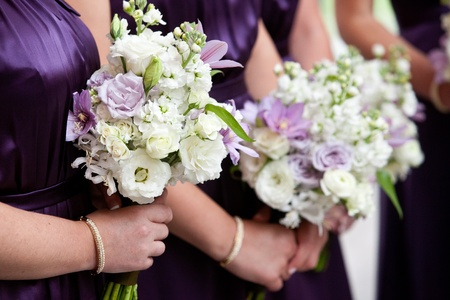 bridesmaid holding bouquet photo