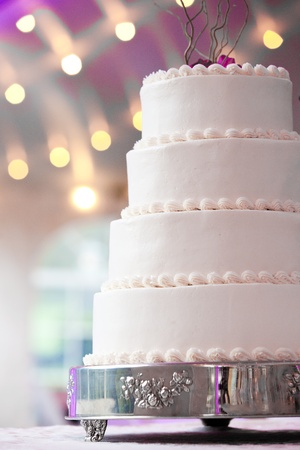 wedding cake: wedding cake with purple and lights in the background