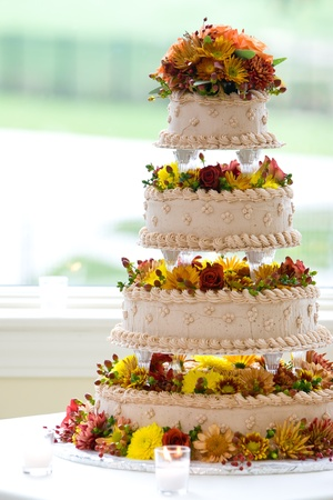 a big wedding cake built on four tiers with flowers  Stock Photo