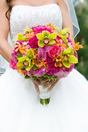 bridal bouquet: Wedding bouquet of flowers held by a bride. Pink, Orange, and Green Stock Photo