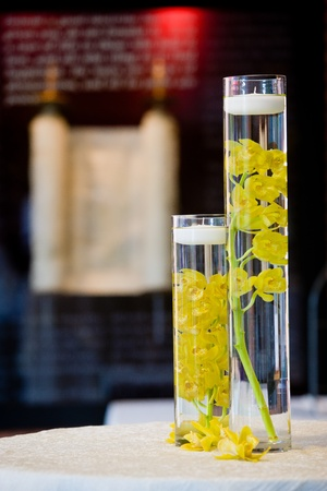 centerpiece: these are yellow orchids floating in water. used as decoration during a wedding
