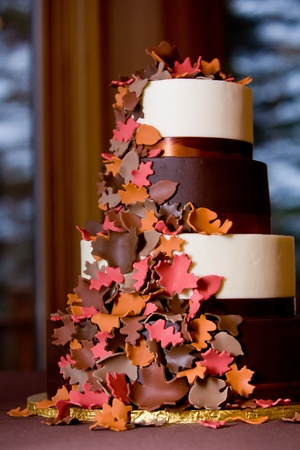 wedding food: A Fancy fall themed wedding cake with sugar leaves falling down the side