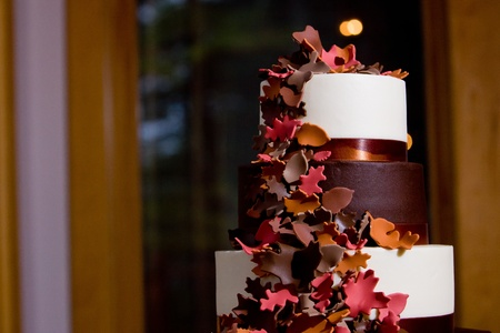 A Fancy fall themed wedding cake with sugar leaves falling down the side Stock Photo - 12869768