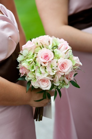 bridal wedding bouquet of flowers in white, pink, and green photo