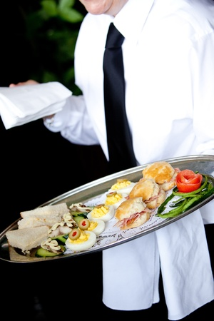 appetizers being served at a catered event of function on a platter Stock Photo