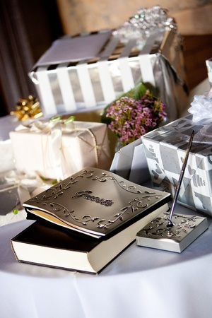 wedding guest: gift table and guest book during a wedding reception