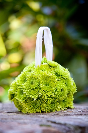 floral arrangements: a hanging flower ball bouquet for a flower girl in green