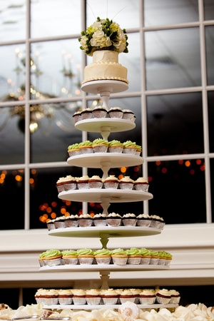 mini cupcakes on a multi level tier in different colors 스톡 콘텐츠