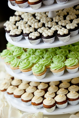 wedding cake: mini cupcakes on a multi level tier in different colors Stock Photo