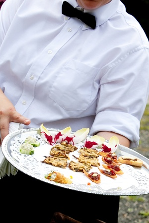 A waiter serving appetizers during a catered wedding or other banquet funtion Stok Fotoğraf