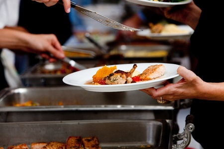 catered: a person in line with their food during a banquet or other catered event