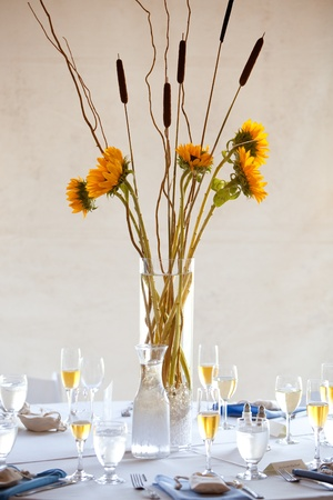 a large wedding table centerpiece with a sunflower bouquet photo