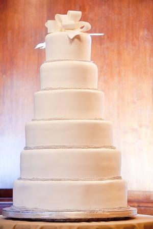 a huge six level white wedding cake on display