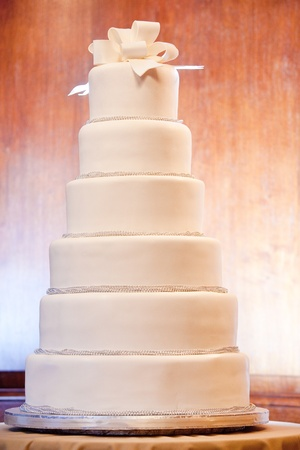 cake tier: a huge six level white wedding cake on display