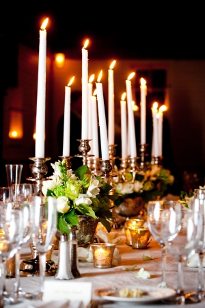 banquets: a large wedding table set for fine dining with lots of candles
