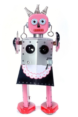 tin robot: vintage toy robot walking toward you on a white background
