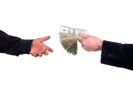 Business man handing cash to another person, loaning money Stock Photo - 13163890