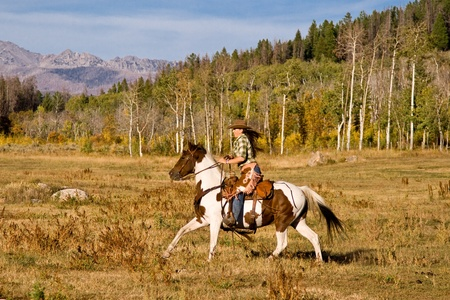 Woman Riding Her Horse photo