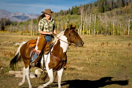 colorado: Woman Riding Her Horse Stock Photo