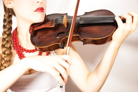 A young folk woman playing a violin photo