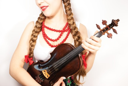 A young folk  woman with a violin or fiddle photo