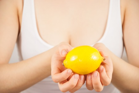 A young woman with a lemon Stock Photo