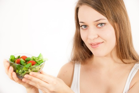 fruity salad: A young beautiful woman with a bowl of salad