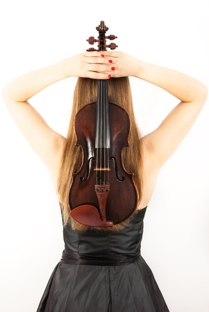 bout: A young woman with a black dress and a violin
