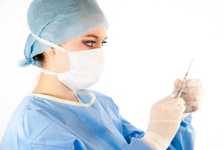 ilness: A young female doctor with a syringe wearing a medical uniform