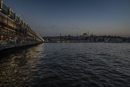 Galata bridge and the golden horn at evening. Stockfoto