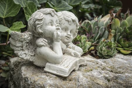Grave decoration angles. Stock Photo