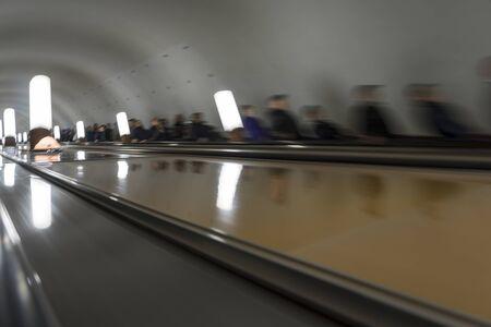 People on moving escalators.