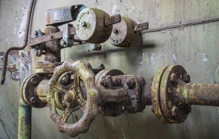 Rusty pipeline with valve. 스톡 콘텐츠