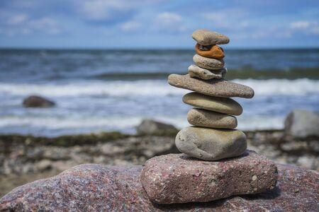 Stacked stones on the baltic sea Foto de archivo